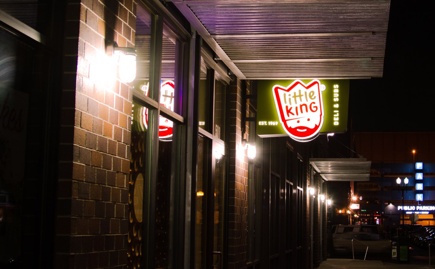 An exterior photograph of Little King at night